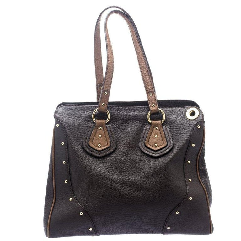 Edgy and different, this tote from Dolce&Gabbana definitely needs to be in your closet. The brown studded creation is crafted from leather and spells creative excellence. It features two handles along with a spacious fabric interior that will hold