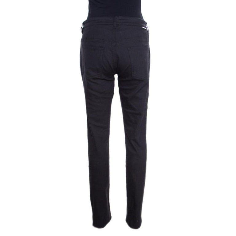 You are instantly going to love these straight fit jeans from Dolce and Gabbana. They are made of a cotton blend flaunting a classic black hue along with buttoned front fastenings and multiple external pockets. Team them up with contrasting polo