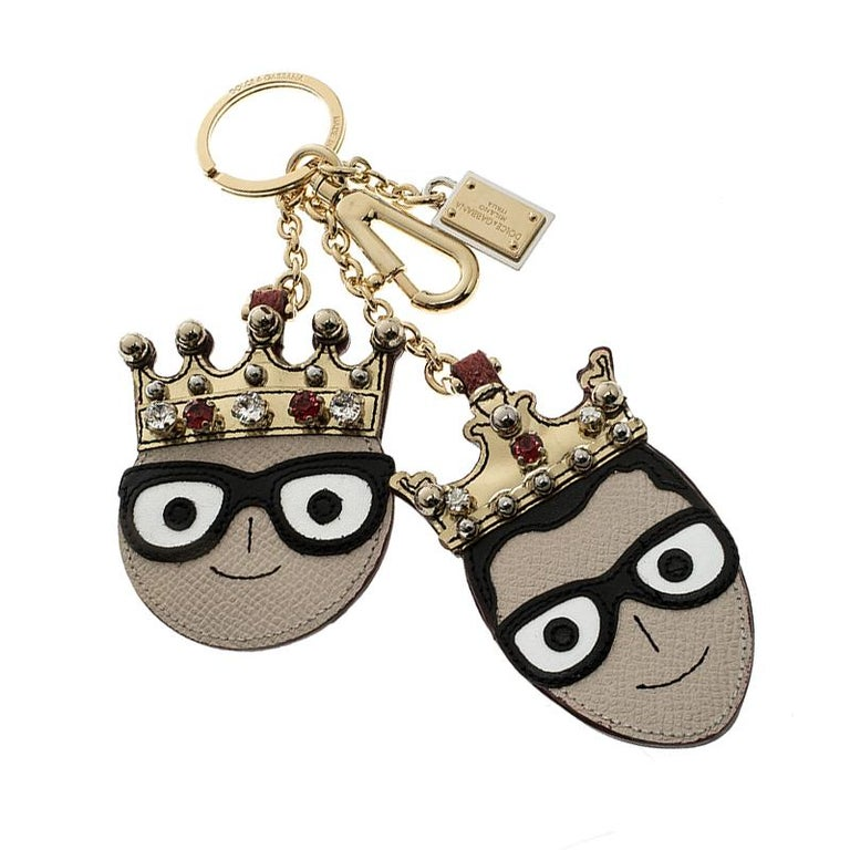 Fun and quirky, this Dolce and Gabbana is the best way to tell the world how big a fan you are of the brand. It features two cute face charms of the designers in leather detailed with crystal embellished crowns on them. It comes with gold tone chain