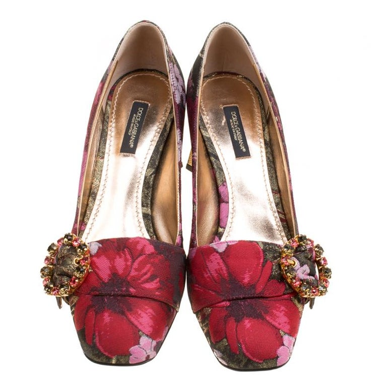 We rarely get to see creations as elegant as these pumps from Dolce and Gabbana. They've been wonderfully designed using floral-printed jacquard fabric and decorated with crystal studded buckles on the vamps and shiny gold block heels which are