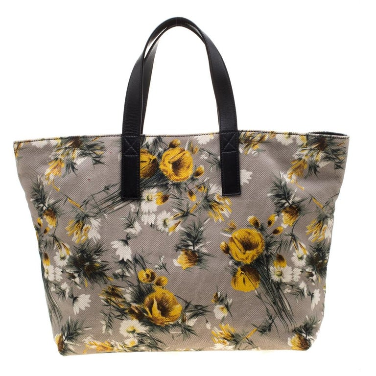 This floral-printed canvas and leather tote is apt for daily use With an expertly lined fabric interior and two leather handles, this can accommodate all your essentials. This piece, from Dolce & Gabbana, is a note on utility and