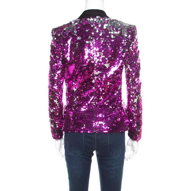 Designed in the most stunning and statement fuscia pink sequin paillette embellishment, this stunning Dolce and Gabbana blazer is a perfect party piece. Featuring a grey velvet trim on lapel collar, this blazer also features button details along the