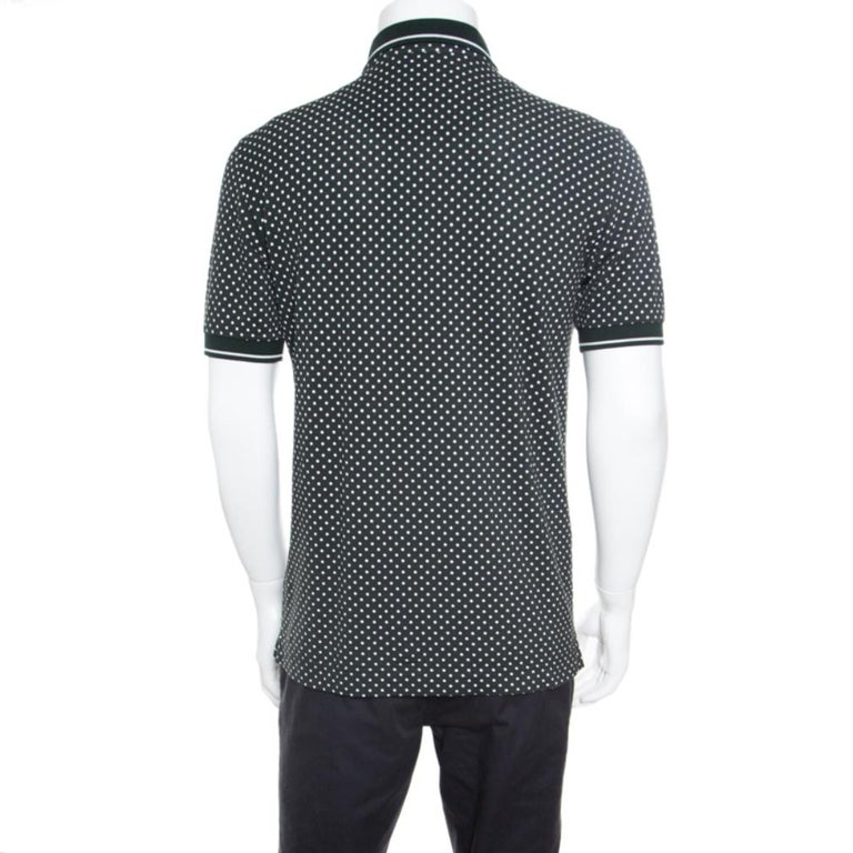 Dolce and Gabbana's polo t-shirt holds a perfect off-duty look. Crafted from breathable cotton, it features classic collars and short sleeves along with an interesting print at the front and polka dots all over in a winning combination of green and