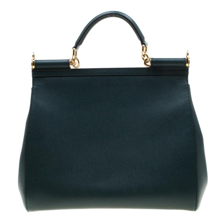 This gorgeous green Miss Sicily satchel from Dolce & Gabbana is crafted from leather. It has a well-structured design and a flap that opens to a compartment with fabric lining and enough space to fit your essentials. The bag comes with gold-tone