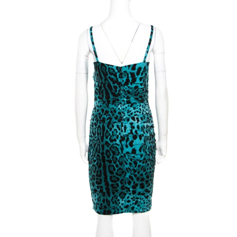 For women who love being stylish in a bold way will love this pretty cocktail dress from the house of Dolce and Gabbana. Fashioned in a fitted silhouette, the dress is conjured from luscious silk blend which is extremely smooth against the skin and