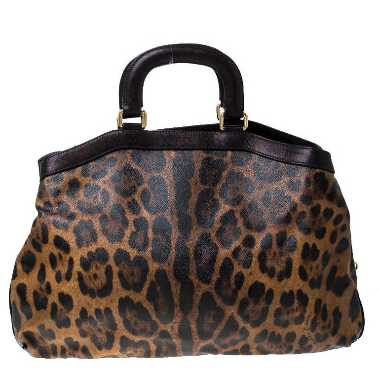 This gorgeous satchel is by Dolce & Gabbana. Crafted from canvas, the bag features leopard-prints all over, two handles and a spacious fabric interior. Swing it along while you travel to lend your outfit the appropriate measure of class and