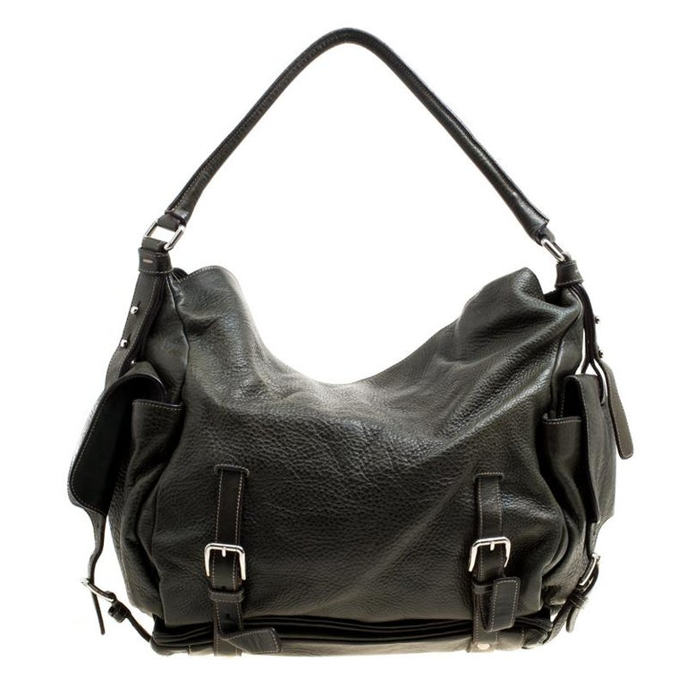 Stylish and handy, Dolce and Gabbana's Miss Forever hobo has been crafted from leather. The mossy green bag features a single top handle, flap pocket on each side and buckle detailing on the exterior. The spacious interior is fabric lined and comes