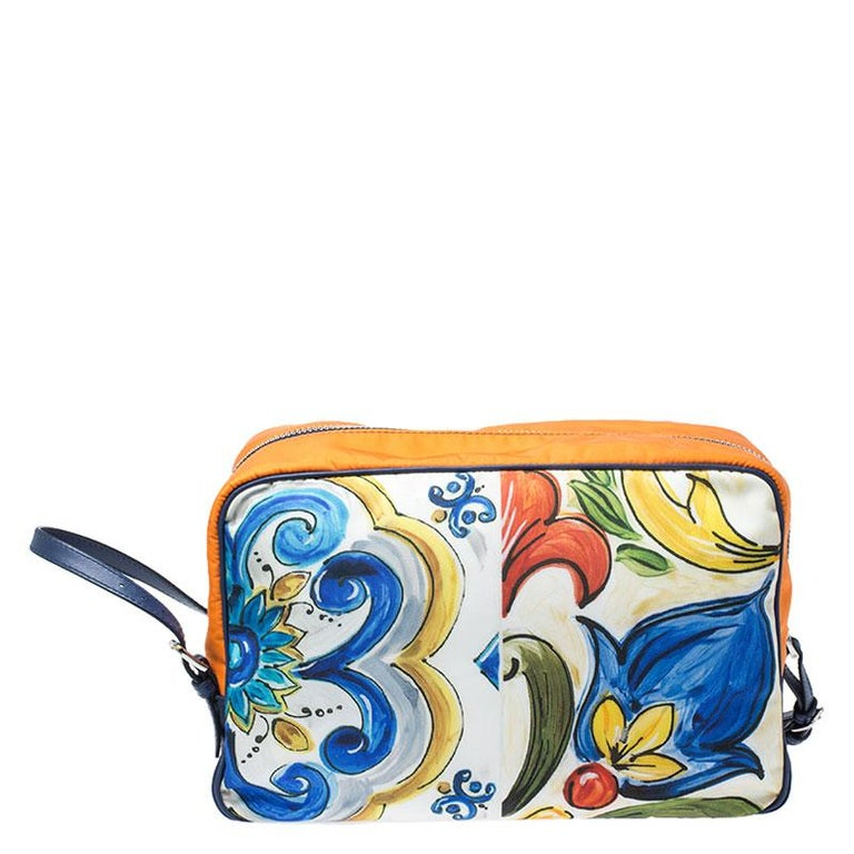 This bag from the house of Dolce & Gabbana has been expertly crafted from quality nylon and secured with top-zip closure. The exterior features a lovely multicolored print that adds interest. It comes with a nylon interior equipped with side