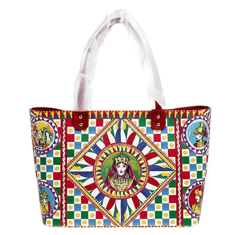 It really does take a few seconds to believe that there could be anything as chic as this Beatrice shopper tote from Dolce and Gabbana. It is crafted from leather and flaunts the iconic Sicilian print all over. It is held by two handles and features