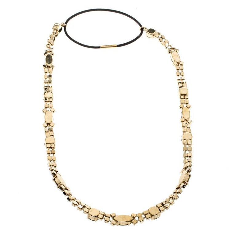 A chic and elegant headband from the house of Dolce and Gabbana, this piece will add a distinct charm and style statement to your look. Constructed in gold-tone metal and styled with crystals, this versatile piece is great to dress you up, or even