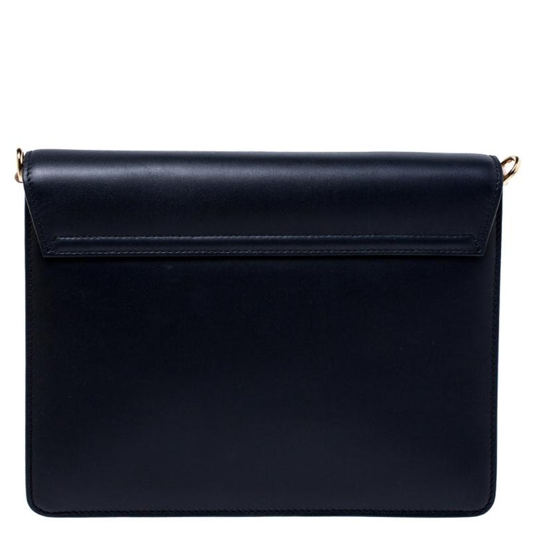 Make an astounding appearance by adorning this gorgeous navy blue leather bag. The leather-lined interior helps you keep your valuables intact without appearing bulky. This piece from Dolce & Gabbana will quench your love for a stylish