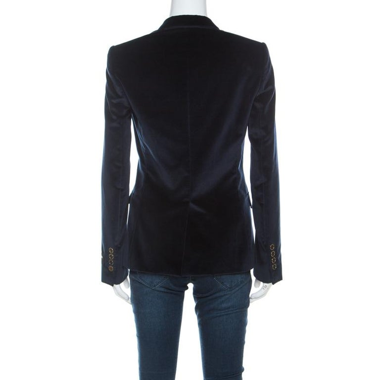 Gorgeous and comfortable, this blazer from Dolce & Gabbana will make others nod in admiration. The fabulous navy blue blazer is tailored from velvet, and it features front buttons, notched lapels and pockets.  Includes: The Luxury Closet Packaging