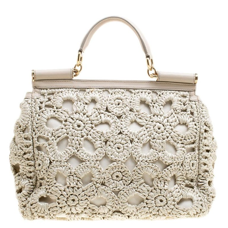 The Miss Sicily tote is one of the most celebrated creations from Dolce and Gabbana. The tote beautifully embodies the spirit of extravagance and feminity that the Italian luxury brand carries. Crafted from Raffia leather the bag features a Crochet