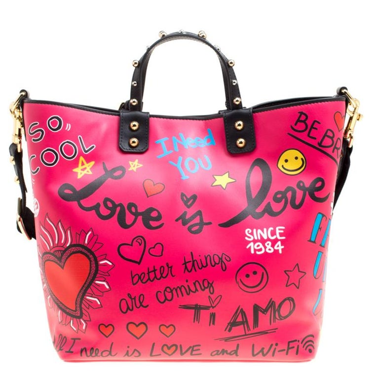 This Dolce and Gabbana Beatrice Shopper is high on style and is sure to grab you never ending compliments! It is crafted from pink leather and features dual top handles, a detachable shoulder strap, and an attached brand logo plaque accent. What