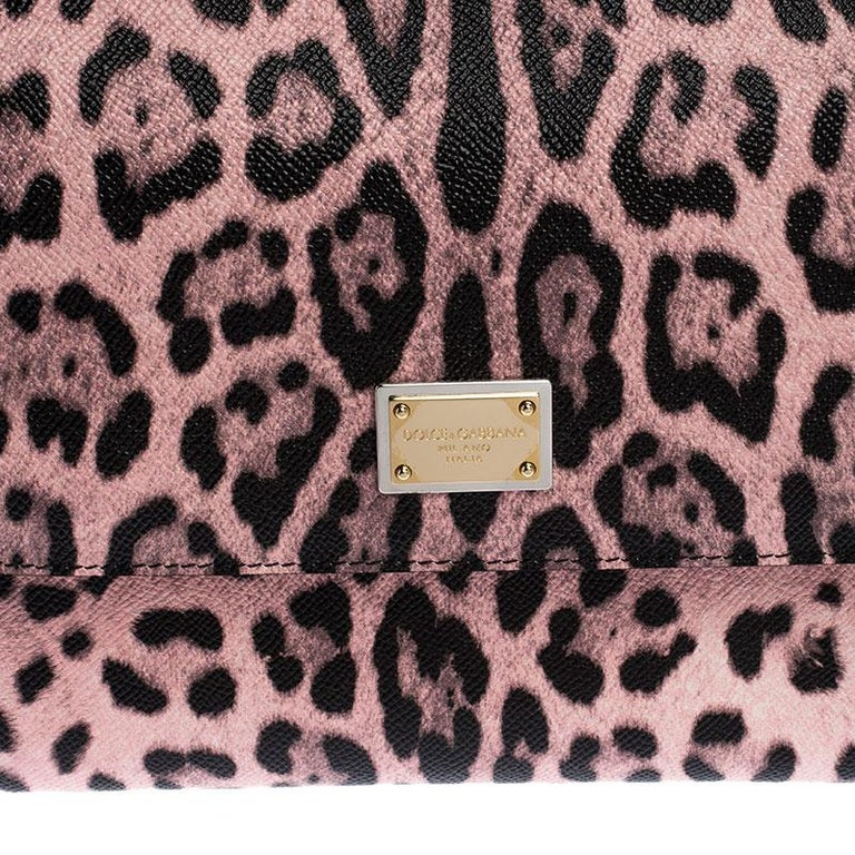 This gorgeous leopard print Miss Sicily bag from Dolce & Gabbana is a handbag coveted by women around the world. It has a well-structured design and a flap that opens to a compartment with fabric lining and enough space to fit your essentials. The