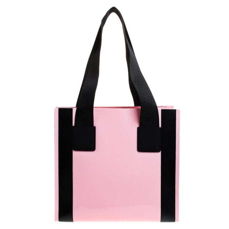A stylish option for everyday use or special events this Dolce and Gabbana bag is true to its existence. Crafted from PVC and held by dual handles, the tote is spacious and will hold all your necessities.  Includes: Info Booklet, Authenticity Card,