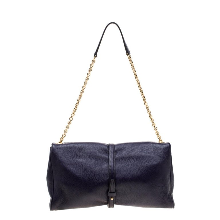 Add a touch of purple to your attire with this attractive leather bag. It has a fabric-lined interior, a chain handle with leather rest, and the logo plaque on the front. This beauty from Dolce & Gabbana is both durable and fashionable!  Includes: