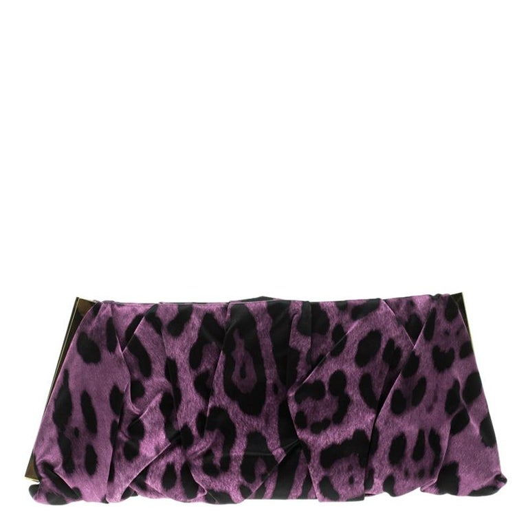 Dolce and Gabbana bring to you the perfect accessory for any evening occasion. Exquisitely crafted into a overlapping fabric fold design, this leopard print clutch can be paired with any ensemble to impart a look of pure grace and