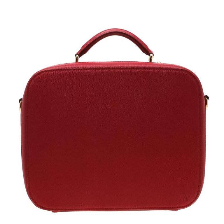 Exclusively designed from the house of Dolce and Gabbana this bag will upgrade your style quotient to another level. Flaunting a structured shape, the bag is crafted from leather in a red hue. Equipped with a shoulder strap and a top handle, the