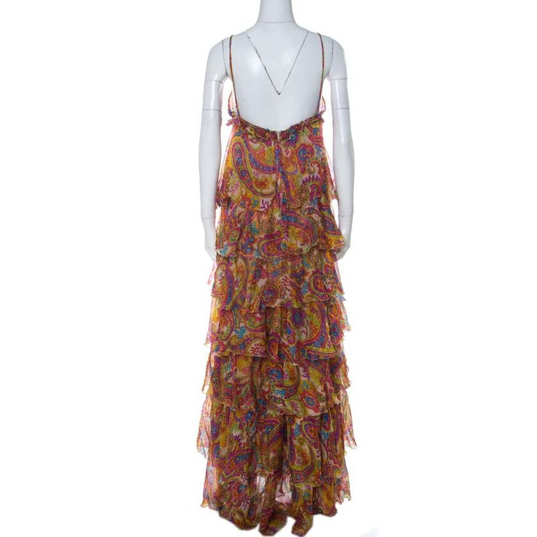 This stunning dress by Dolce & Gabanna, a label known for its extravagant, head-turner creations. The dress is made from silk with a fitted bodice and ruffles in a tiered design below the bust. Held with straps, the sleeveless dress comes with a zip