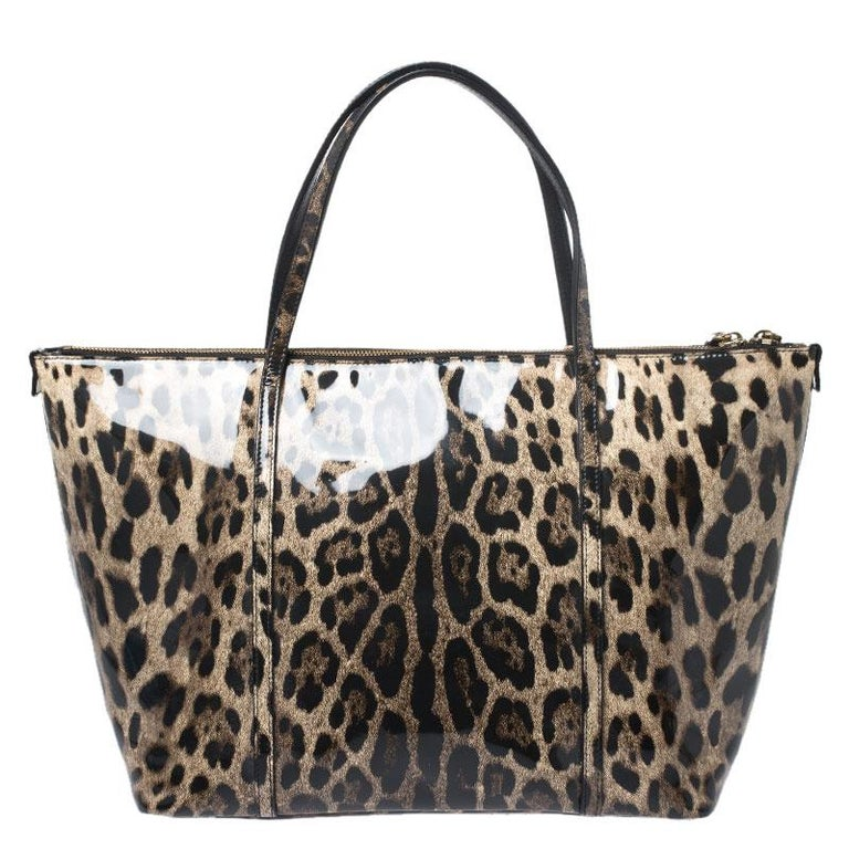 This stunning tote is from the house of Dolce & Gabbana. Crafted from leopard-printed patent leather, and lined with fabric on the insides, the Miss Escape tote features dual top handles and a gold-tone logo plaque flaunted on the front. Swing it