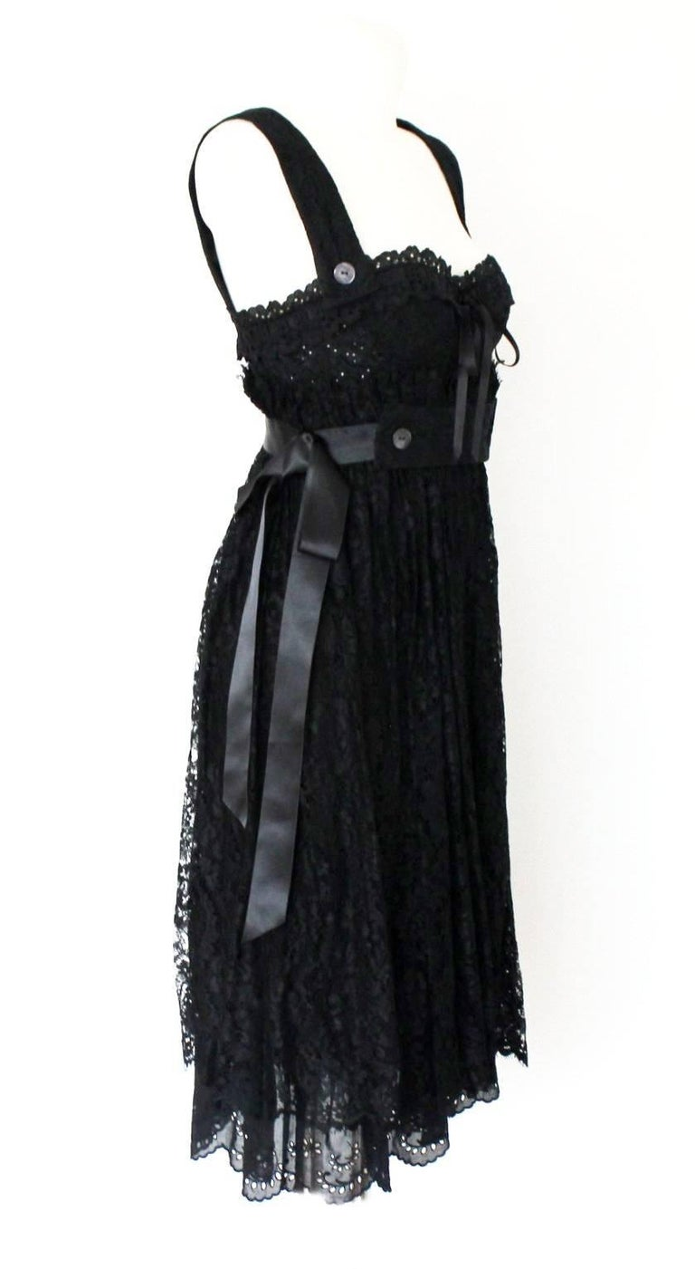 GORGEOUS DOLCE & GABBANA BLACK CORSET LACE DRESS  DETAILS:      A DOLCE & GABBANA classic signature piece that will last you for years     Made out of a fantastic material combination mix     Black eyelet corset top     Skirt made out of finest
