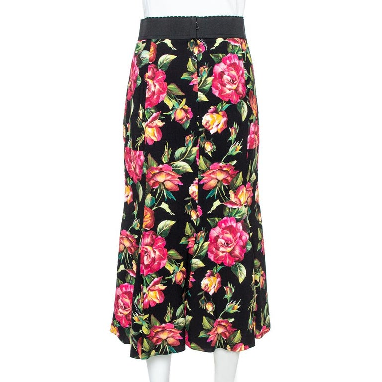 Dolce & Gabbana's skirt is graced with a flare that adds a subtle feminine charm to it. It comes in a beautiful black color with a lovely floral print all over, rear zip closure, and elasticized waistband. Wear this with a statement top and heels