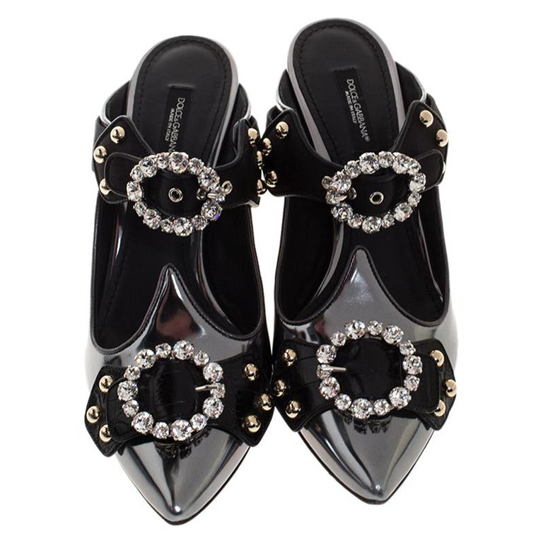These sandals coming from the fashion house of Dolce & Gabbana showcase a versatile and feminine look. Crafted from leather and satin, they are highlighted with embellished buckles and pointed toes. The striking pair is set on 7.5 cm