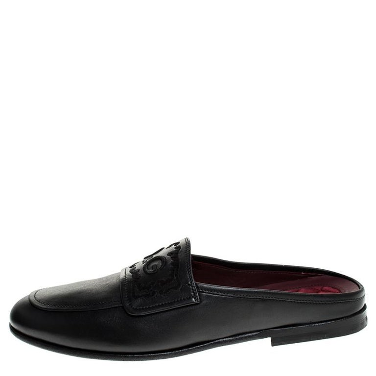 Mule loafers have become the season's most coveted trend and we can see why- it's super comfortable and classy that can work all day without any hassle, just like these Dolce & Gabbana's King City pair. They are crafted from the black leather body