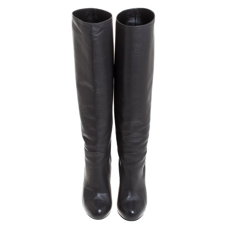Creations as fashionable as this pair of knee-length boots from Dolce & Gabbana deserves to be in every woman's closet. They've been created from leather and designed with covered toes and 12 cm heels.