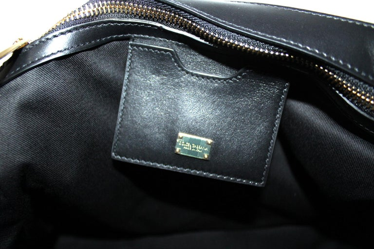 Dolce & Gabbana Monica model bag made of black leather with gold hardware.  Equipped with handle and removable shoulder strap. Hook closure, internally large for the essentials.  The bag is in like new condition, still with tag.