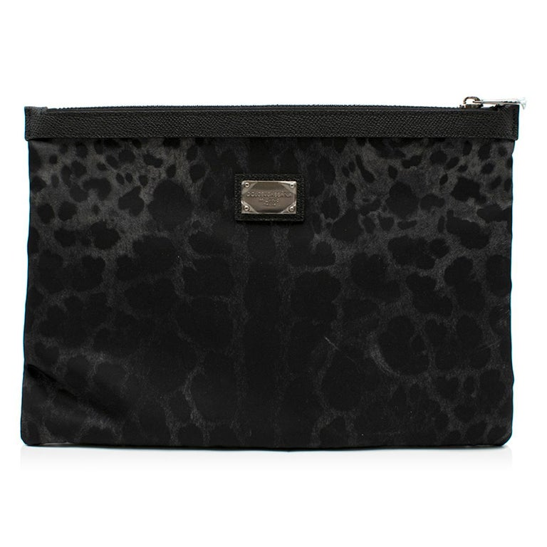 Dolce & Gabbana Black Leopard Print Pouch  - Nylon leopard print pouch  - Black leather trim - Silver tone zip fastening  This item comes with the original box and dust bag   Please note, these items are pre-owned and may show some signs of storage,