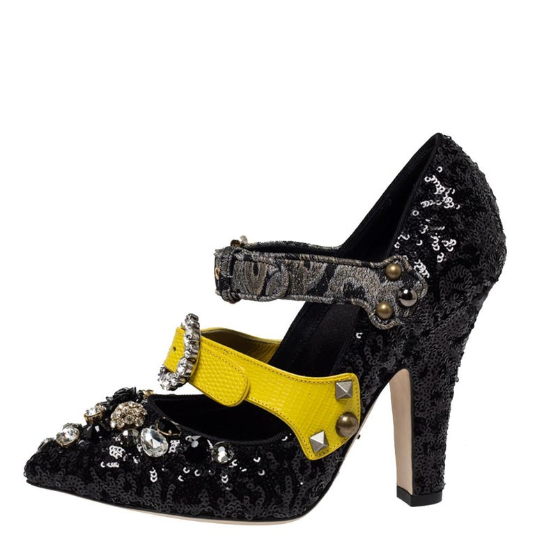 Everything about these Mixed Media pumps from Dolce & Gabbana is charming and impressive. They are covered in black sequins all over and feature a Mary-Jane silhouette with triple straps across the uppers. Further, the pair is enhanced with crystal