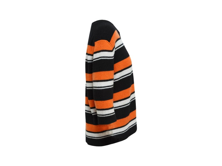 Product details: Black, orange and white cashmere knit top by Dolce & Gabbana. Striped pattern throughout. Crew neck. Three-quarter sleeves. 46