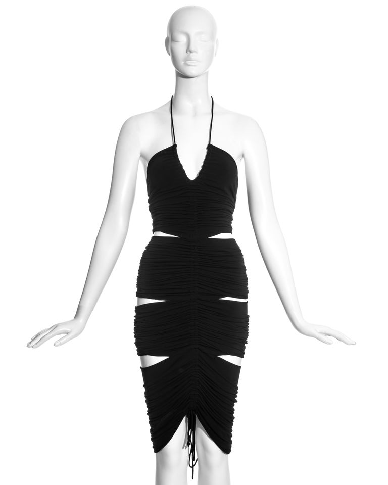 Dolce & Gabbana black rayon figure-hugging halter neck dress with two drawstring ruched seams; front and back, and six skin baring cut-outs.   Spring-Summer 2003