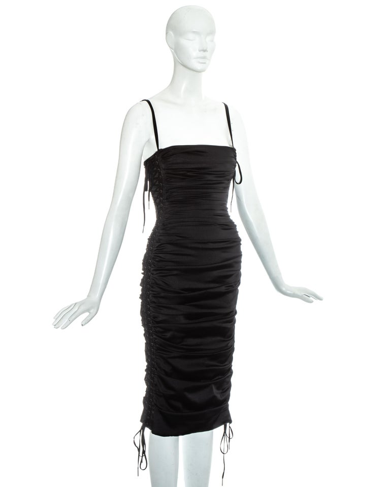 Dolce & Gabbana black ruched silk figure hugging mid-length evening dress with lace up fastenings on side panels and built in satin bra with adjustable shoulder straps  Spring-Summer 2003