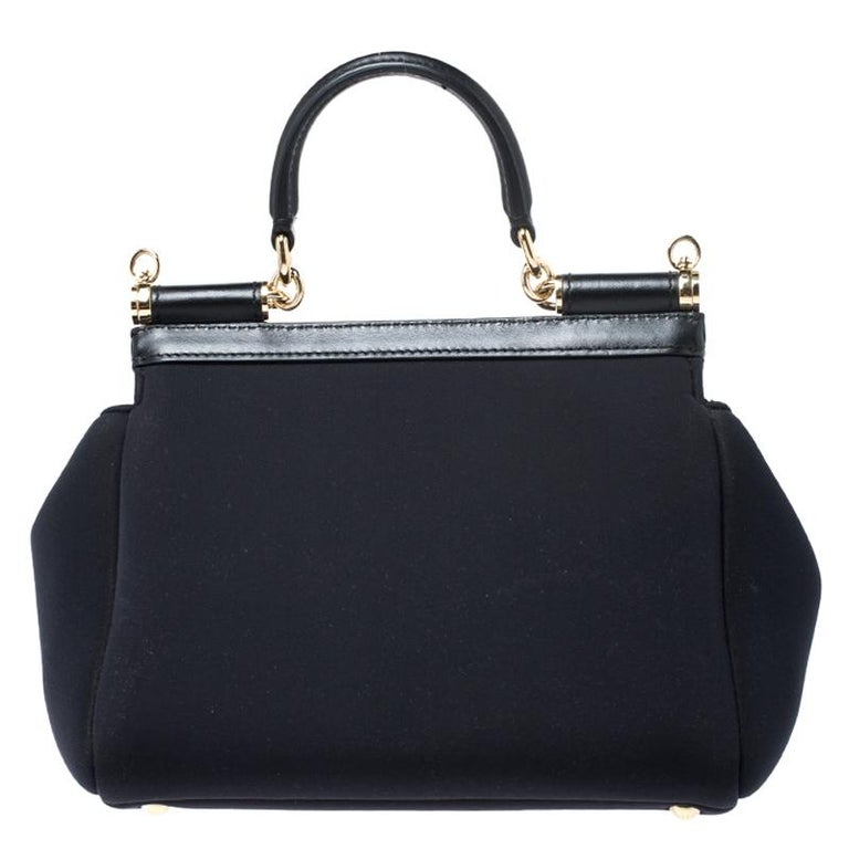 This gorgeous black Miss Sicily bag from Dolce & Gabbana is a handbag coveted by women around the world. It has a well-designed satin body and a flap that opens to a compartment with fabric lining and enough space to fit your essentials. The bag