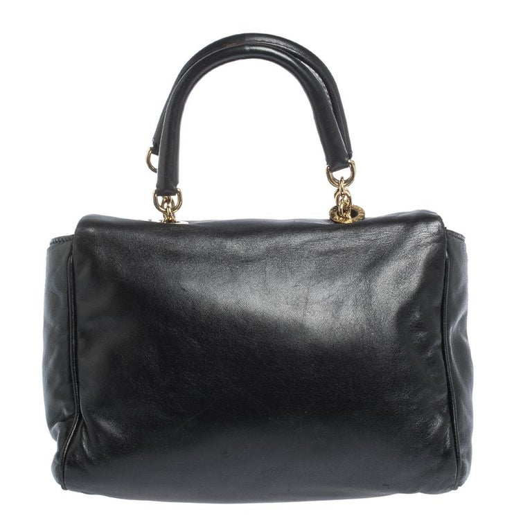 An absolute delight, this satchel is a Dolce & Gabbana creation. Crafted from soft black leather, the bag features two handles, the brand logo on the front flap and a satin-lined interior sized perfectly to hold your essentials. This satchel is a