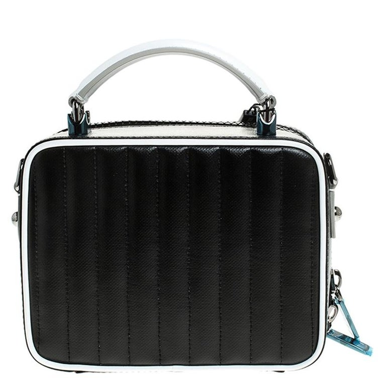 This DG Girls bag from Dolce & Gabbana is here to end all your fashion woes, as it is striking in appeal and utterly high on style. It has been crafted from black and white DG coated canvas. The insides are lined with fabric and the bag is complete