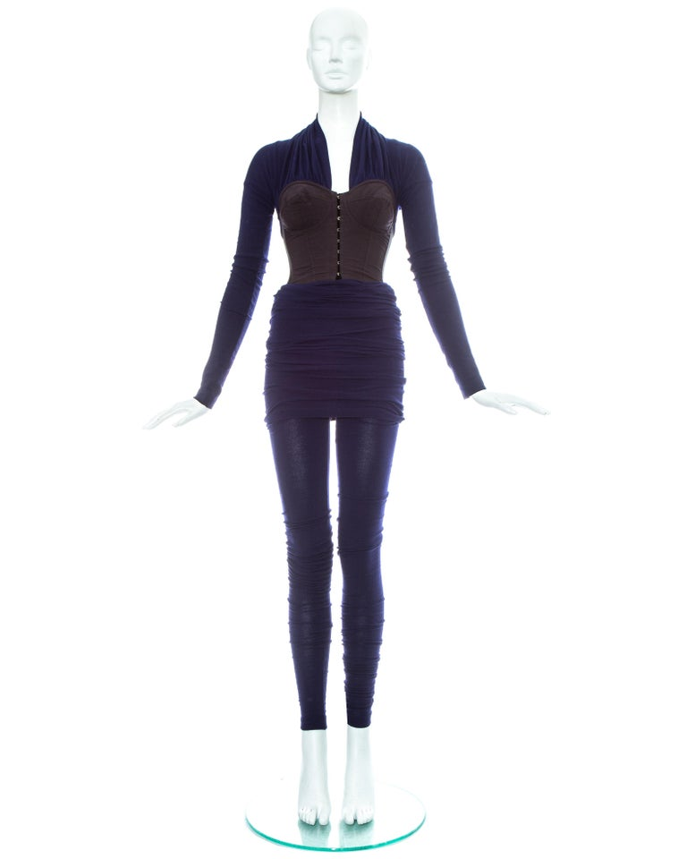 Dolce & Gabbana; blue cotton elastic jersey jumpsuit consisting of a corset and leggings.     - Boned corset with hook and eye metal fastenings and long fitted sleeves  - Extra long leggings with turn-over skirt; designed to be ruched up the leg