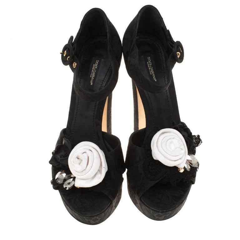 Designed to a feminine finish, these Dolce & Gabbana sandals are gorgeous. Crafted from brocade fabric, they are highlighted with flower and crystal detailing and feature open toes along with ankle straps. They come with leather lined insoles that