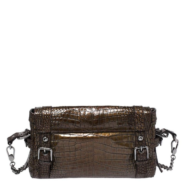 This chic Miss Easy Way bag by Dolce and Gabbana will enhance both your casual and evening wear. Crafted from croc embossed patent leather in brown, it is decorated with the brand plaque and a zip pocket on the front. The bag is equipped with a