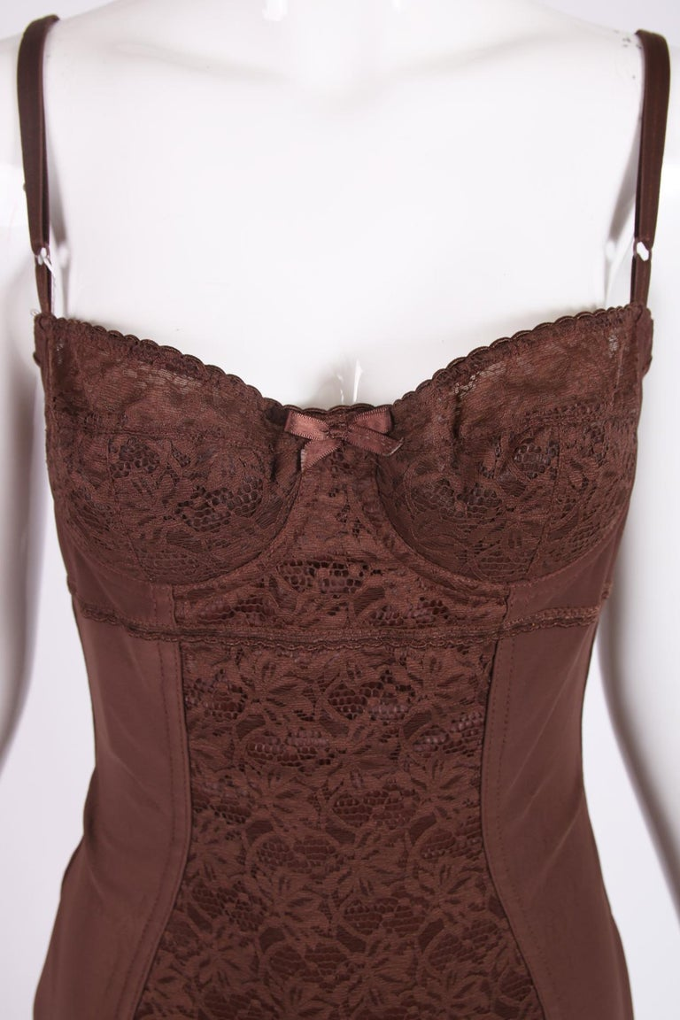 Dolce & Gabbana brown stretch bodysuit with lace at the bust and center front panel. Bra straps are sizable, and there are hook and eye closures at the crotch. Size tag 44. Fabric is a nylon, elastane blend. In excellent condition, with original