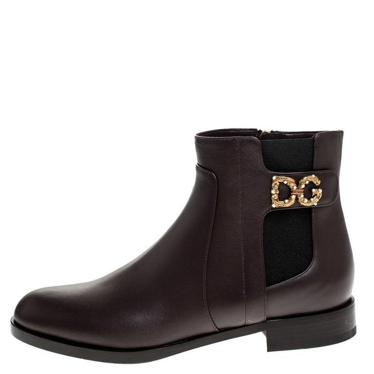 Any lover of luxury will agree that Dolce & Gabbana's designs are not only high on style but also comes from excellent workmanship, just like these brown ankle boots. Covered in leather and shaped wonderfully, these simple ankle boots have round