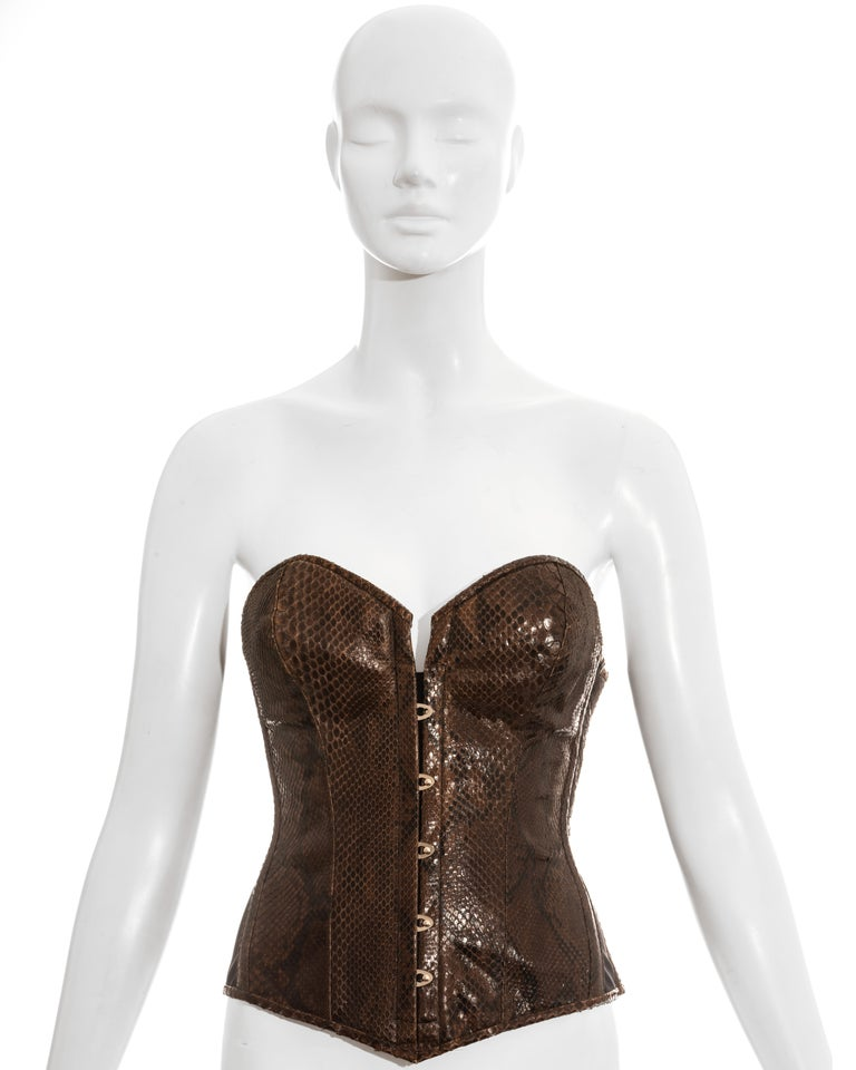 Dolce & Gabbana bustier corset constructed with brown python skin. Lace up back fastening, metal hook front closures and side zip fastening.  Spring-Summer 2005
