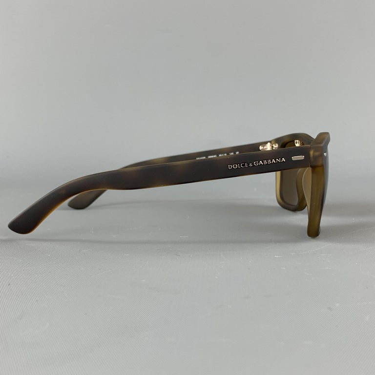 DOLCE & GABBANA sunglasses come in tortoiseshell print rubberized acetate with brown polarized lenses. With case.  Excellent Pre-Owned Condition.  Measurements:  Length: 15 cm. Height: 5 cm.