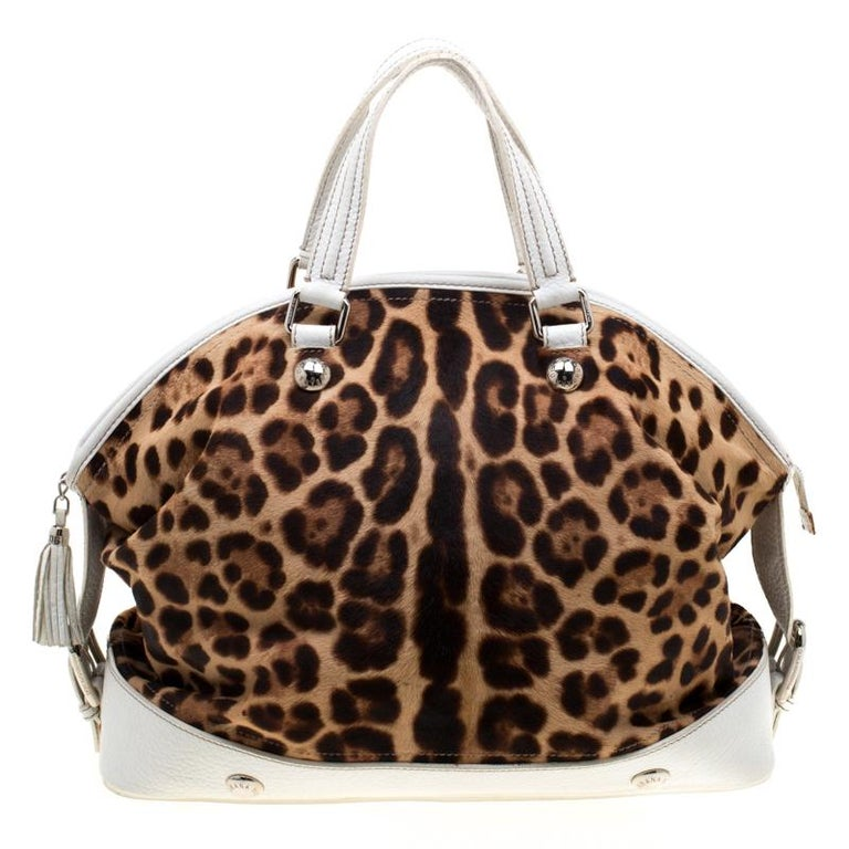 This stunning satchel is by Dolce & Gabbana. Crafted from calf hair and leather, the bag features leopard-prints, two handles, and a spacious fabric interior. Swing it along while you travel to lend your outfit the appropriate measure of class and