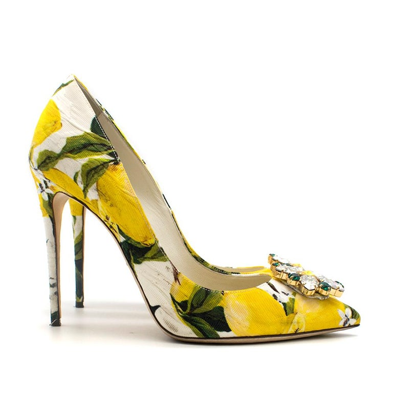 Dolce & Gabbana stilettos with a bright yellow lemon pattern. RRP £745  - Pointed toe - Crystal embellished toe - Heel height 11cm  - Pattern leather insole - Made in Italy  Please note, these items are pre-owned and may show signs of being stored