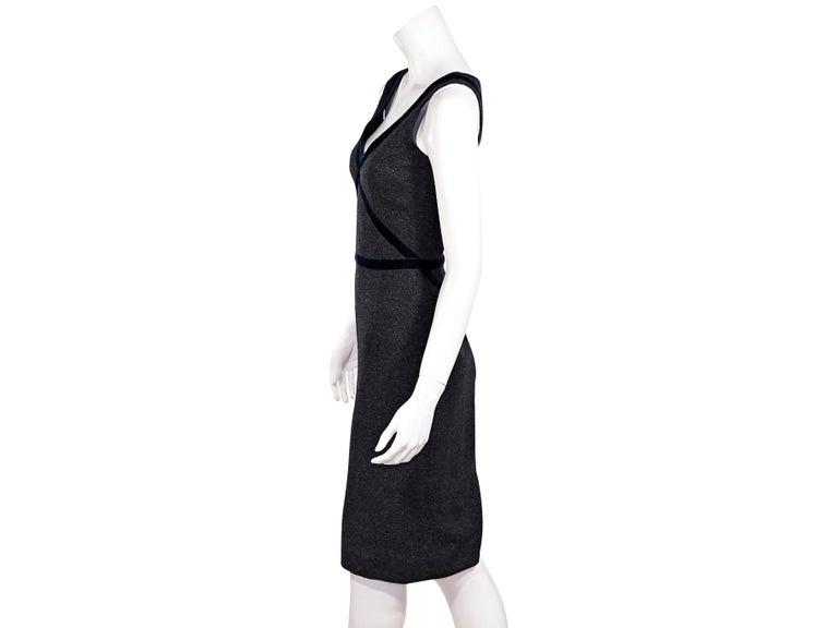 Product details:  Dark grey stretch-wool-blend sheath dress by Dolce & Gabbana.  Trimmed with blue velvet.  V-neck.  Sleeveless.  Concealed back zip closure.  Center back hem vent.  32