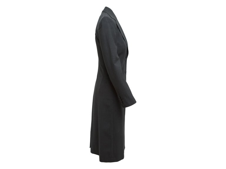 Product details: Dark grey wool long coat by Dolce & Gabbana. Notch collar. Dual pockets at hips. Button closures at center front. Designer size 38. 34